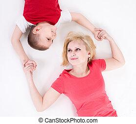 anya, összeillesztett, birtoklás, emelet, hands., fekszik, fiú