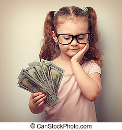 csinos, gondolkodó, pénz, dollárok, kéz, látszó, hogyan, súlyos, kölyök, költ, szemüveg