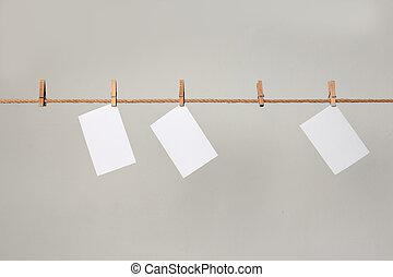 fénykép, paper., ruhaszárító kötél, függő, fehér, clothespins.