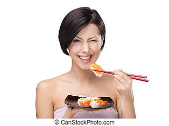 gyönyörű woman, étkezési, sushi