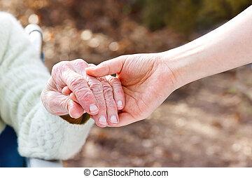házfelügyelő, fiatal, hatalom kezezés, idősebb ember, hölgy