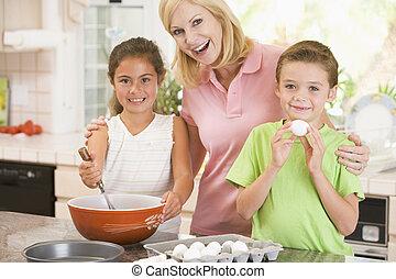 nő, sülő, két, mosolygós, gyerekek, konyha