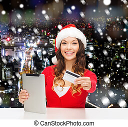 nő, tabletta pc, hitel, santa kalap, kártya