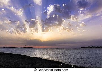 napnyugta, köves tengerpart