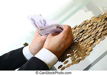 pénz, kitart kezezés