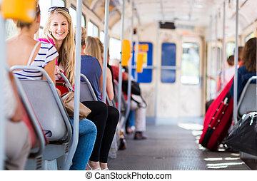 streetcar/tramway, nő, meglehetősen, fiatal