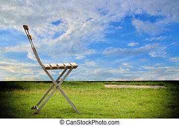 zöld szék, fű, öreg